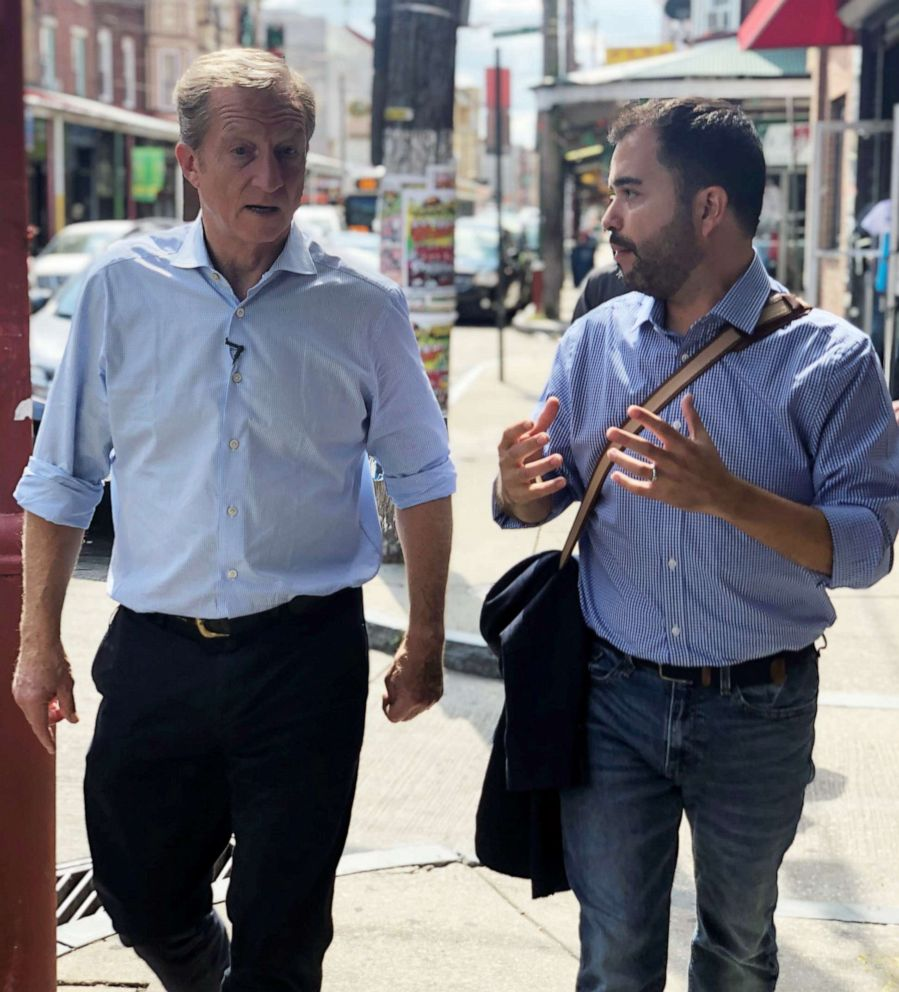 PHOTO: Tom Steyer walks with an aide during a campaign stop in South Philadelphia, Sept. 18, 2019.
