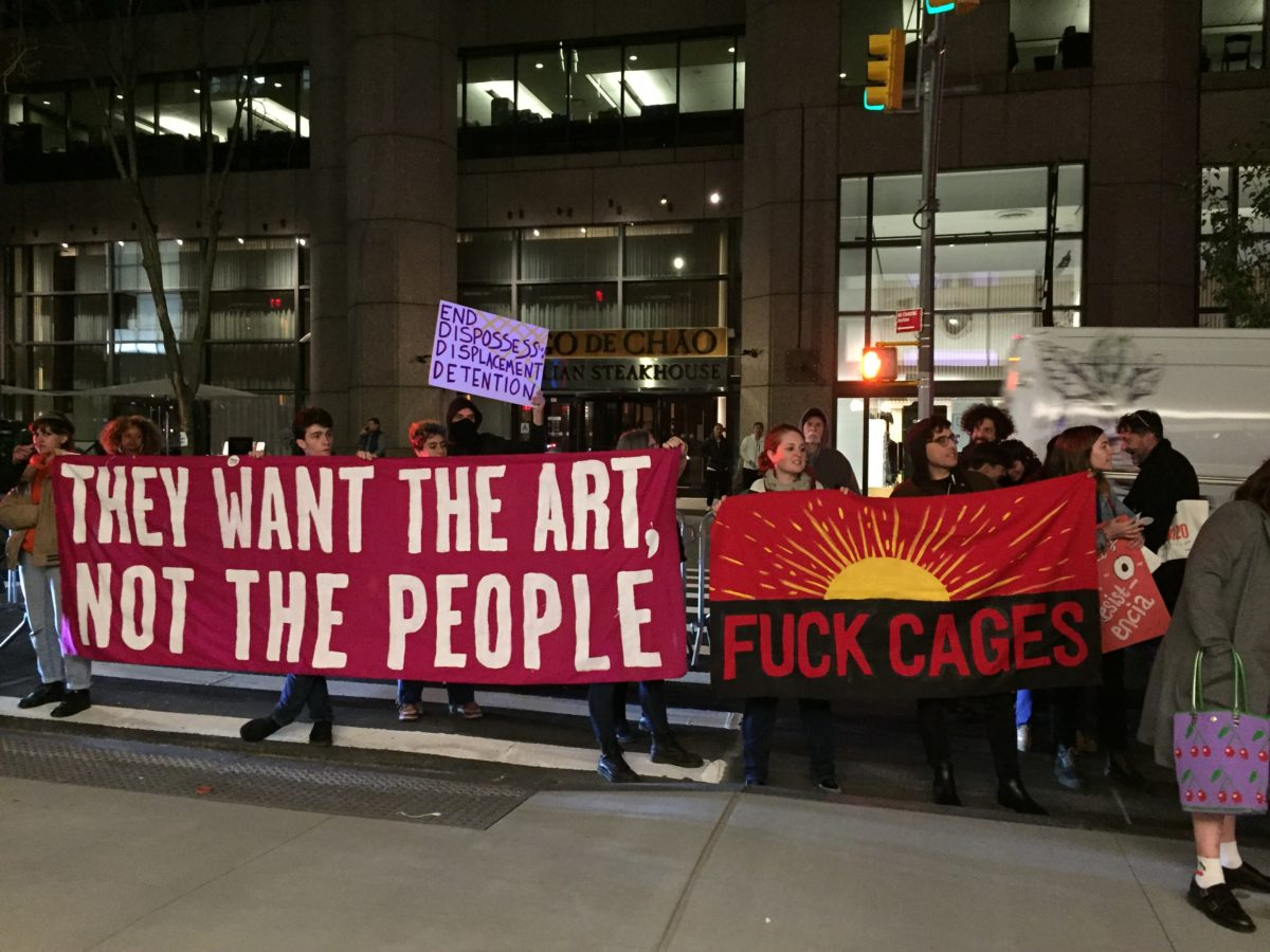 A protest at the Museum of Modern Art's opening party on October 18, 2019.