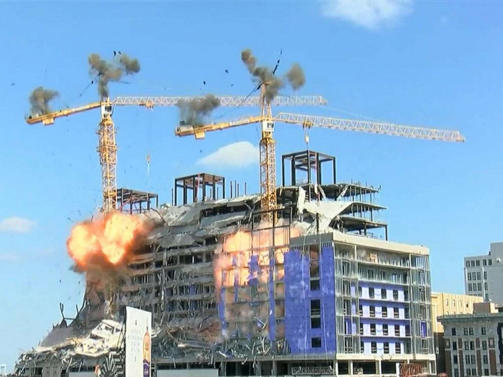 PHOTO: A controlled demolition brought down one of the cranes standing atop the Hard Rock Hotel in New Orleans, Oct. 20, 2019.