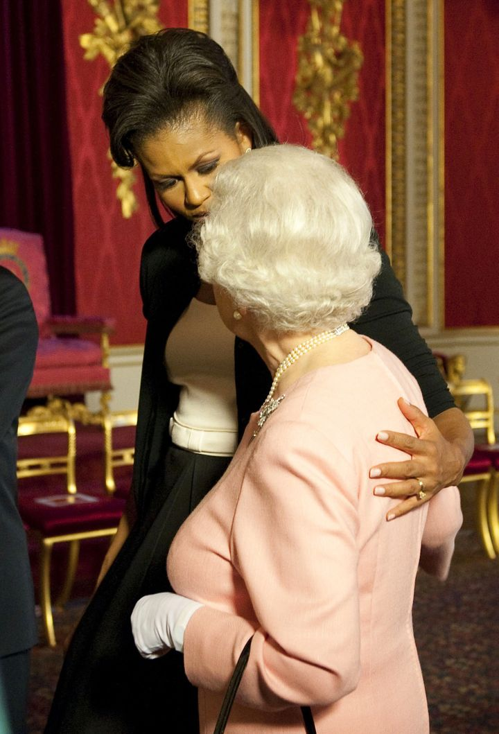Then-first lady Michelle Obama walks with Queen Elizabeth at a reception at Buckingham Palace on April 1, 2009.