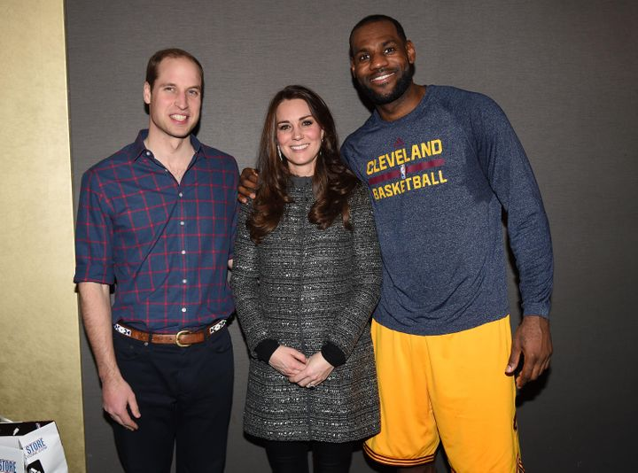 William and the Duchess of Cambridge pose with LeBron James as they attend a Cleveland Cavaliers vs. Brooklyn Nets game on De