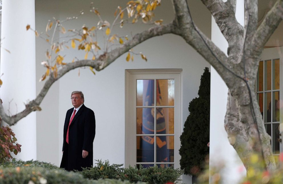 PHOTO: President Donald Trump walks out of the Oval Office headed to the Marine One helicopter to depart for travel to Fla., from the South Lawn of the White House in Washington, Nov. 26, 2019.