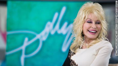 Country queen Dolly Parton makes a surprise appearance at the Newport Folk Festival