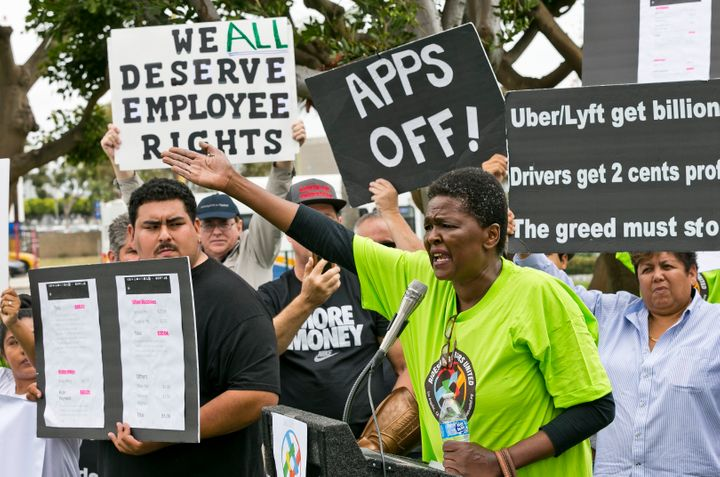 Uber driver Estaphanie St. Just joins drivers for ride-hailing giants Uber and Lyft as they hold a rally near Los Angeles Int
