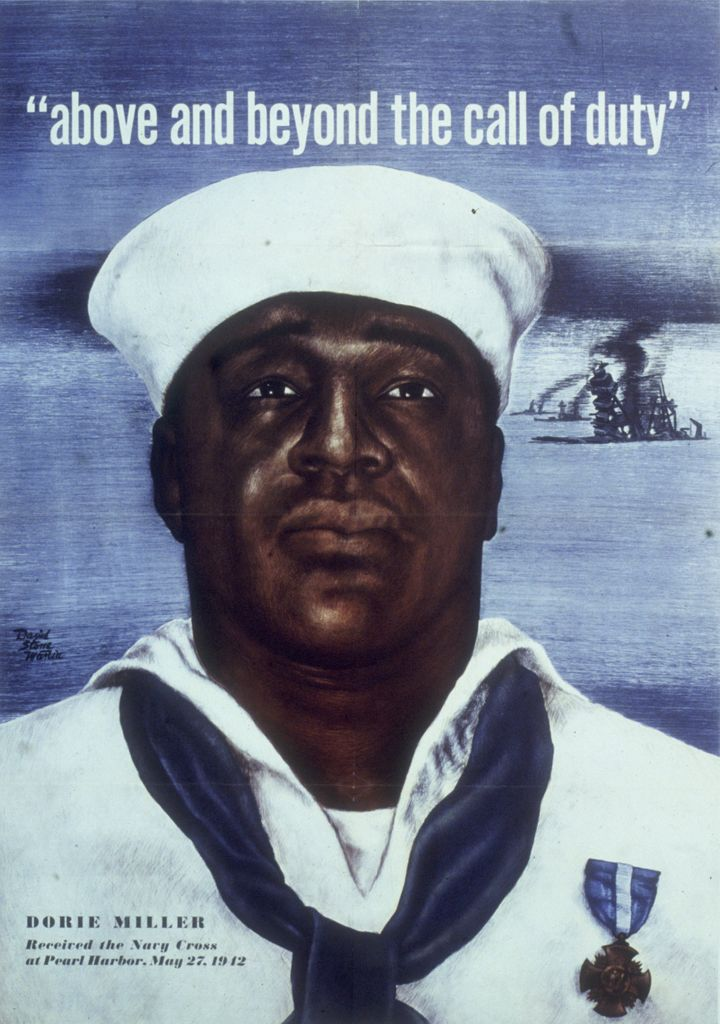 Circa 1942: Headshot portrait of Naval Mess Attendant 3rd Class Doris Miller, wearing a Navy Cross pinned to his sailor's uni