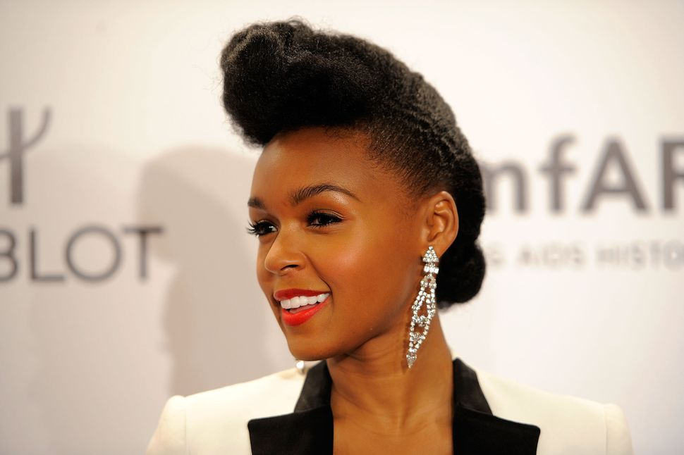 Singer Janelle Monae attends the amfAR New York Gala To Kick Off Fall 2012 Fashion Week at Cipriani Wall Street on Feb. 8, 20