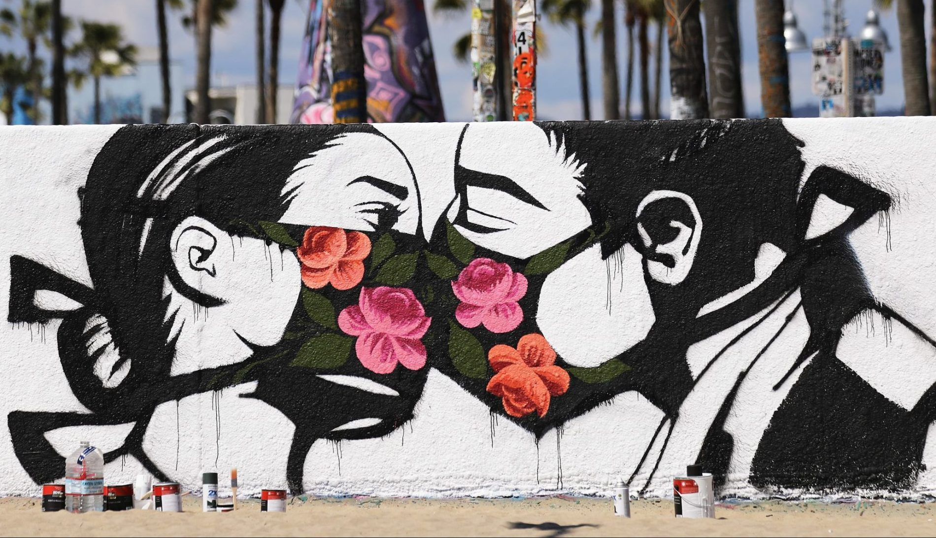 mural kissing coronavirus theGrio.com