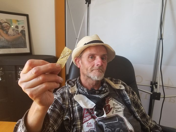 "Derek ""D-Rock"" Williams with a piece of the golden glitter from the ""America's Got Talent"" audition."