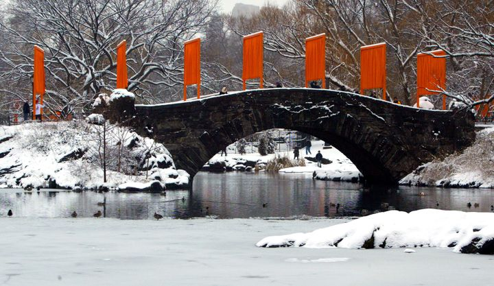"""""""The Gates"""" art installation created by Christo and Jeanne-Claude lines a snow-covered bridge in New York's Central Park in 2"""