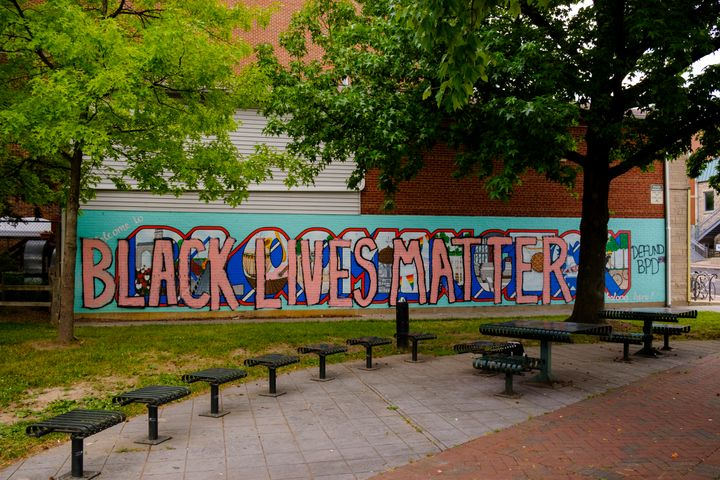 """The words """"Black Lives Matter"""" are painted over a mural in Bloomington, Indiana, on June 19. Bloomington is about 70 miles so"""