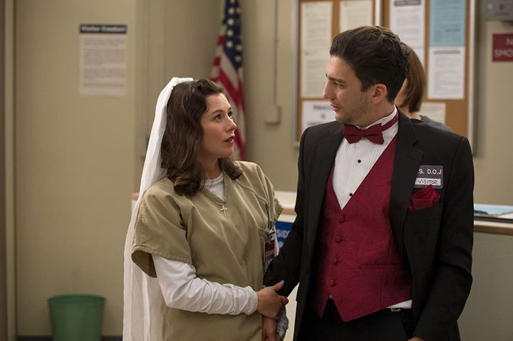 "Magaro with Yael Stone in an episode of ""Orange Is the New Black."" He appeared in 11 episodes of the popular Netflix series."