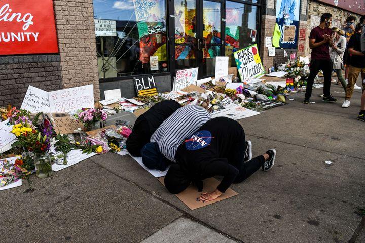 Muslim women offer evening prayers at a makeshift memorial in honor of George Floyd in Minneapolis on June 4.