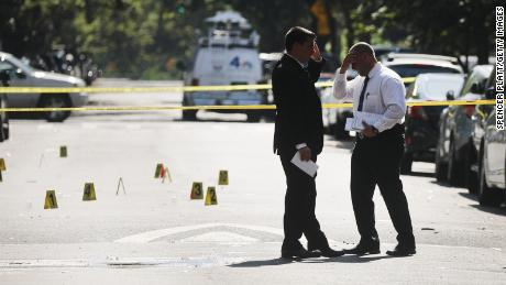 Police work a crime scene in Brooklyn where a 1-year-old boy was killed July 13 when gunfire erupted at a family picnic.
