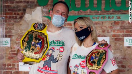 Competitive eaters Joey Chestnut and Miki Sudo after winning their respective divisions with new world records at the Nathan's Famous Hot Dog Eating Contest on Saturday.