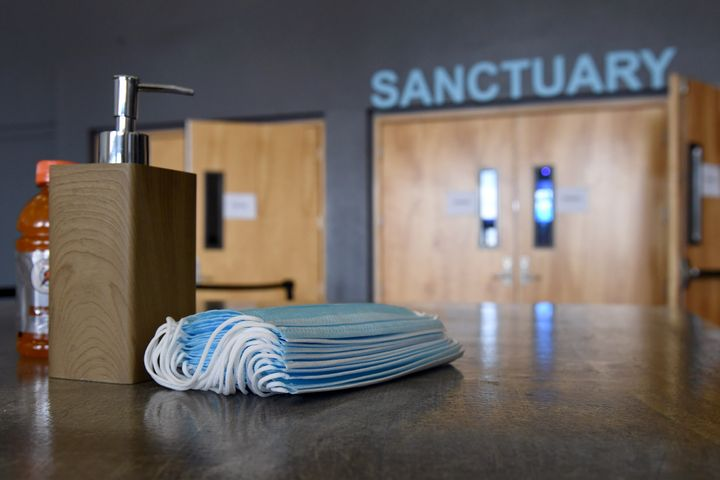 Hand sanitizer and face masks are placed on tables at the sanctuary entrance of a church in Las Vegas on May 31.