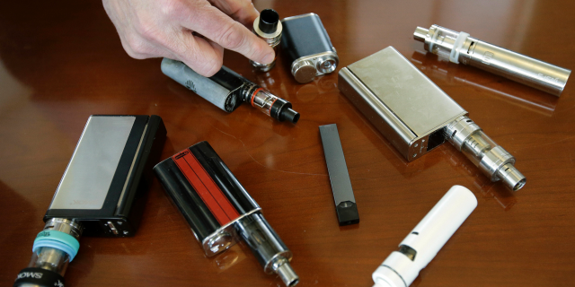 As of last year, more than 5 million youths were using e-cigs, according to the Food and Drug Administration. (AP Photo/Steven Senne)