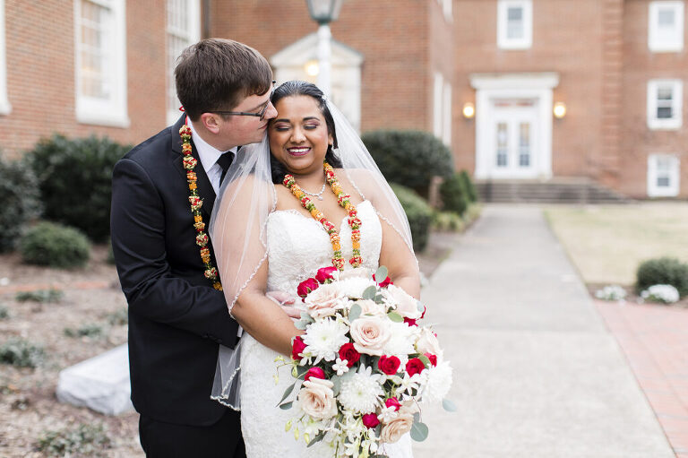 Bride and groom smiling in front of the Historic Post Office in Hampton, Virginia.