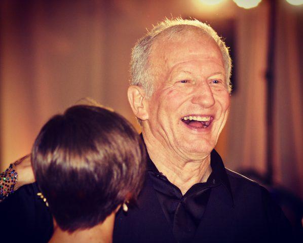 Senior man laughing and dancing