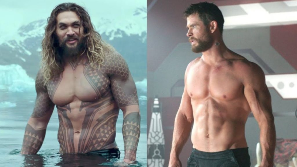 shirtless Jason Momoa as Aquaman and shirtless Chris Helms