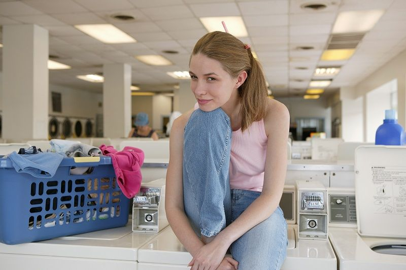 Woman-posing-in-laundry-facility
