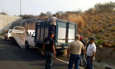 Hallan cuerpos en camioneta