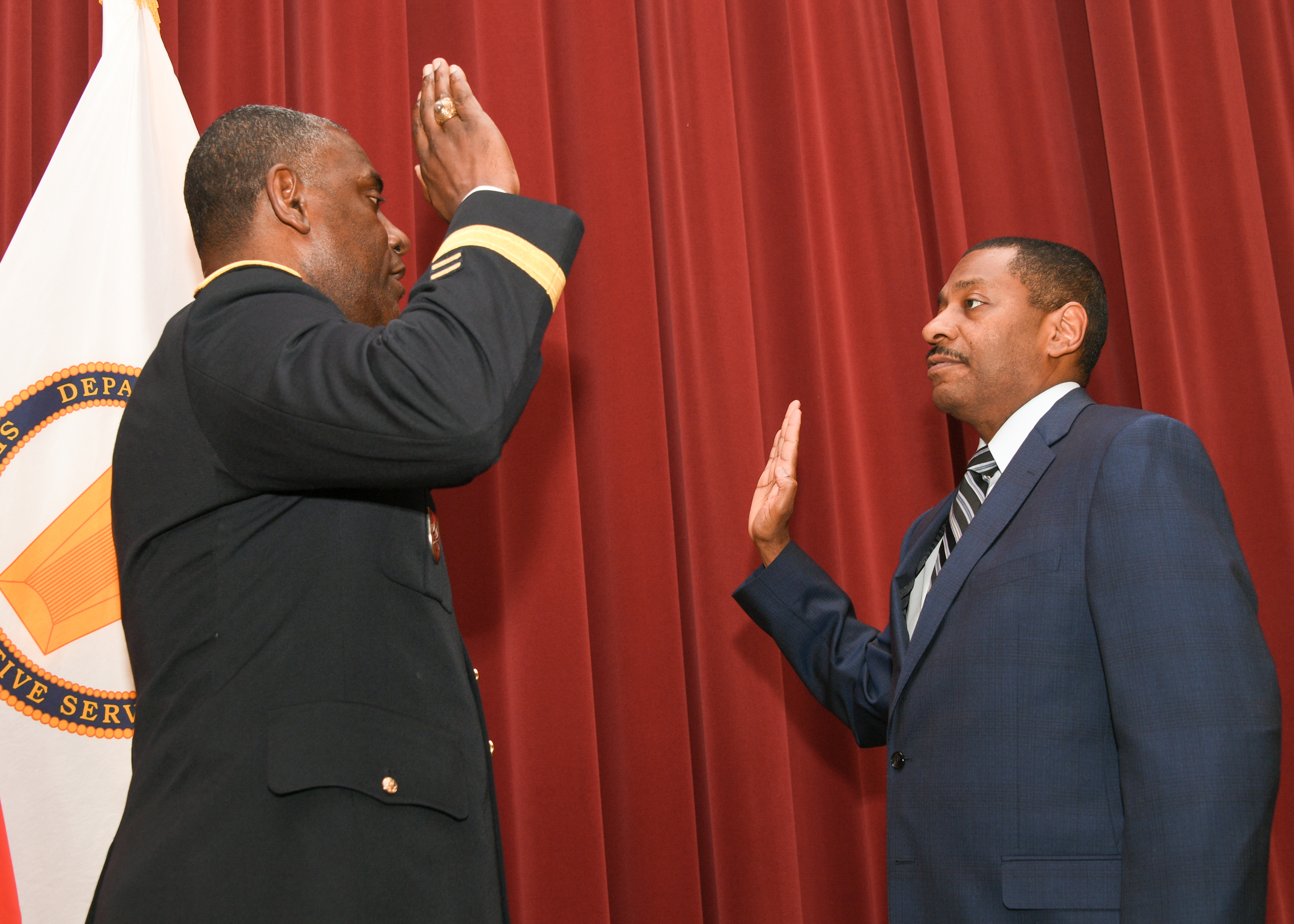Major General Cedric Wins, commanding general of the U.S. Army Research, Development and Engineering Command, swears in Dr. Eric Moore as director of the U.S. Army Edgewood Chemical Biological Center. (Photo Credit: RDECOM PAO)