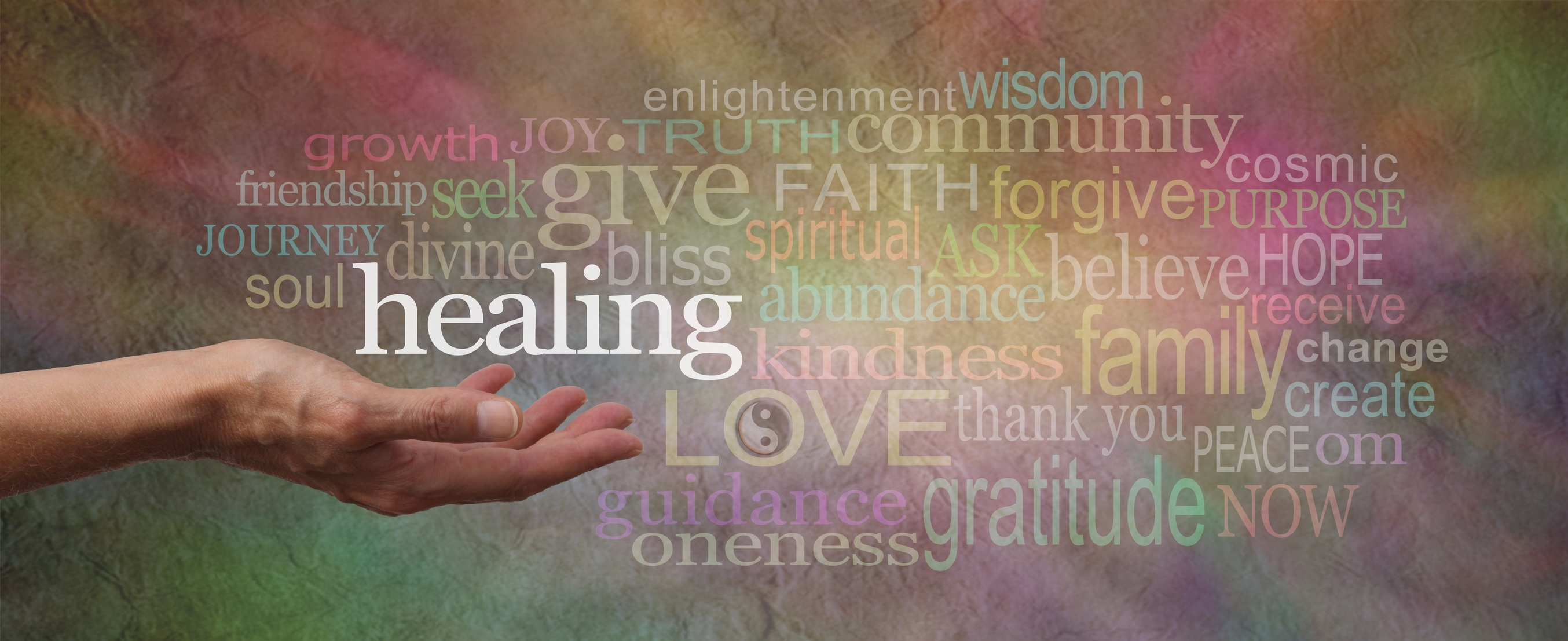 Wide softly colored stone effect banner with a female hand facing upwards surrounded by a word cloud relative to healing