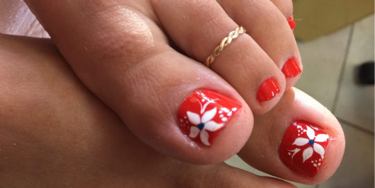 Red Toes With White Flower