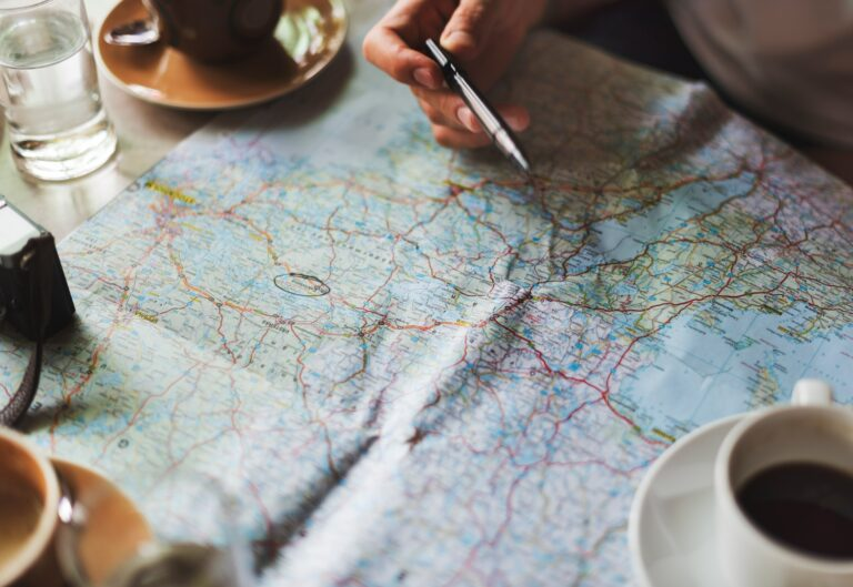 planning out adventure on a map