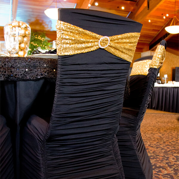 Black Spandex Chair Covers | Celebrations by Rent-All located in Sioux Center | Wedding Rental | Chair Covers For Rent