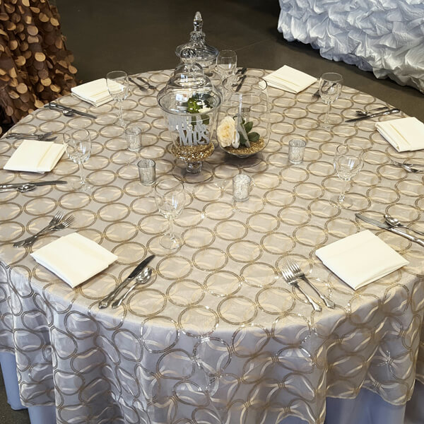 Champagne Circle Sequin Tablecloth | Celebrations by Rent-All located in Sioux Center | Wedding Rental | Overlay Tablecloths For Rent