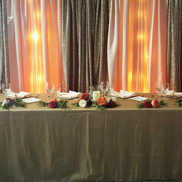 Champagne Crushed Taffeta Tablecloth | Celebrations by Rent-All located in Sioux Center | Wedding Rental | Overlay Tablecloths For Rent