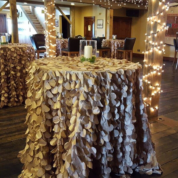 Champagne Flower Petal Tablecloth | Celebrations by Rent-All located in Sioux Center | Wedding Rental | Tablecloths For Rent
