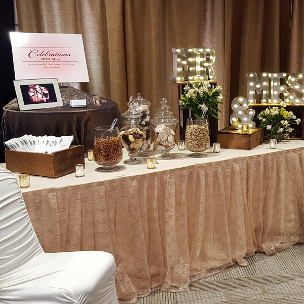 Champagne Lace Table Skirt | Celebrations by Rent-All located in Sioux Center | Wedding Rental | Table Skirting For Rent