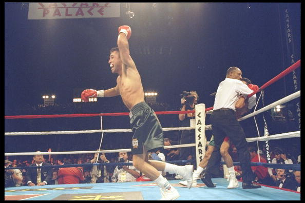 6 May 1996: Oscar De La Hoya celebrates after a fight against Rafael Ruelas. De La Hoya won the fight with a second round technical knockout.