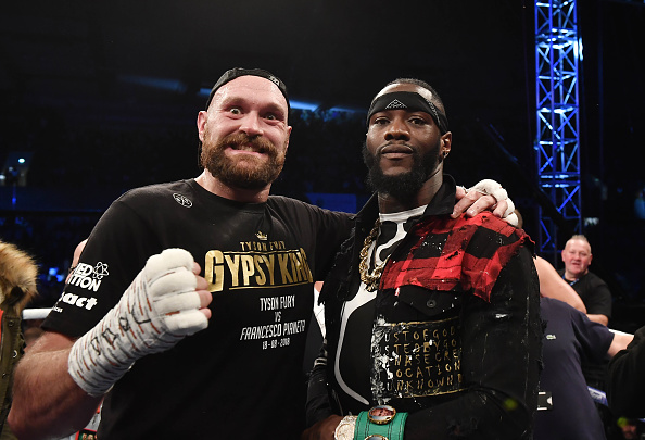 Tyson Fury and Deontay Wilder pose together in Belfast