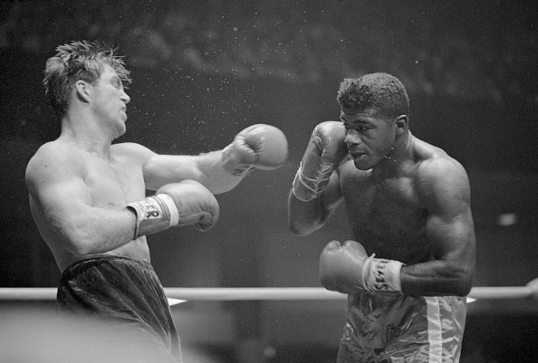 Jerry Quarry (l) takes a swing at Floyd Patterson during their heavyweight bout. Quarry defeated Patterson after 12 rounds.