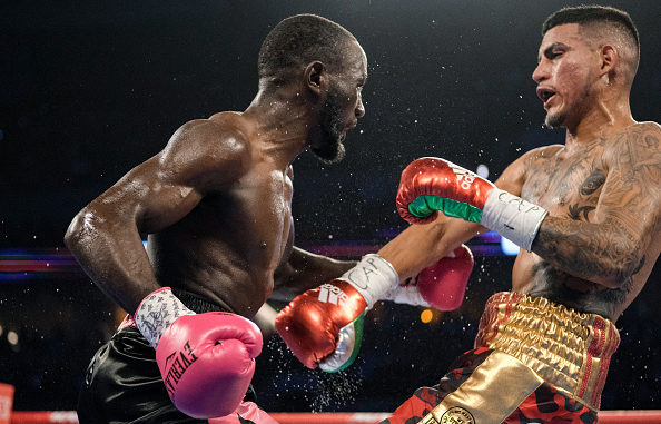 Bud Crawford forces Jose Benavidez to focus on the fight during their match on October 13, 2018 in Omaha, Nebraska. Image credit: Eric Francis/Getty Images