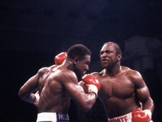 LAS VEGAS - MARCH 11,1989: Michael Dokes (R) lands a punch against Evander Holyfield during the fight at Caesars Palace in Las Vegas, Nevada. Evander Holyfield won the WBC Continental Americas heavyweight title by a TKO 10. (Photo by: The Ring Magazine/Getty Images)