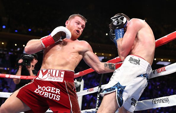 NEW YORK, NEW YORK - DECEMBER 15: Canelo Alvarez punches Rocky Fielding during their WBA super middleweight title fight at Madison Square Garden on December 15, 2018 in New York City. (Photo by Al Bello/Getty Images)