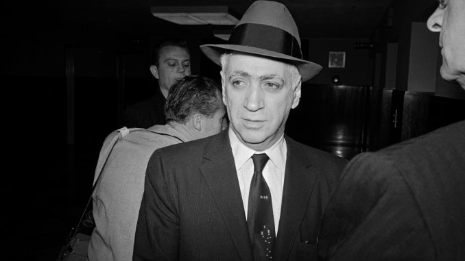 Frankie Carbo enters US District Court here December 2nd, where he faces trial on charges of trying to share in welterweight champion Don Jordon's earnings. Carbo was sentenced to two years in New York November 30th for his undercover boxing operations.