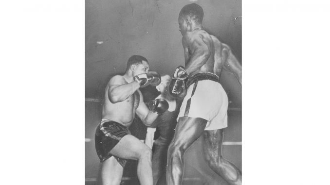 Archie Moore in the ring against Ezzard Charles, May 20, 1946. (Getty Images)