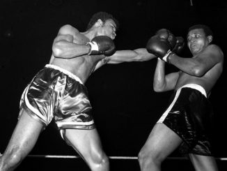 Sport, Boxing, England, 11th September 1973, Great Britain's John Conteh, the British European and Commonwealth Light-Heavyweight Champion (left), is pictured in action as he beat Vincente Rondon (Venezuela), The referee stopped the fight in the 9th round (Photo by Popperfoto via Getty Images/Getty Images)