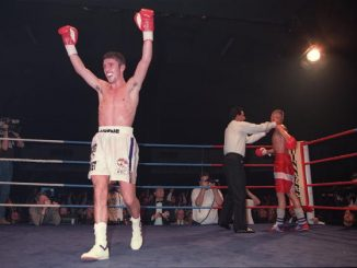 2 DEC 1995: WAYNE McCULLOUGH CELEBRATES HIS VICTORY IN THE RING AFTER THE REFEREE STOPS HIS WBC BANTAMWEIGHT DEFENCE FIGHT AGAINST CHALLENGER JOHNNY BREDAHL AT THE KINGS HALL IN BELFAST. MCCULLOUGH RETAINED HIS TITLE WITH AN EIGHTH ROUND TKO OF THE PREVIOUSLY UNDEFEATED BREDAHL AFTER REFEREE LUPE GARCIA STEPPED IN TO STOP THE FIGHT. Mandatory Credit: Mike Cooper/ALLSPORT