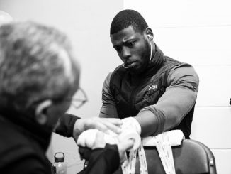 Jorge Rubio, the Cuban trainer based in Miami, wraps Chamberlain's hands before his last fight - against Luke Watkins at York Hall in London on 27 October 2018.