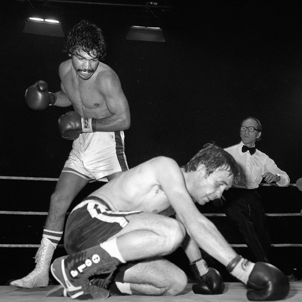 Carlos Palomino floors world welterweight champion John Stracey for the second time in the 12th round. Referee Sid Nathan stopped the fight. (Photo by PA Images via Getty Images)