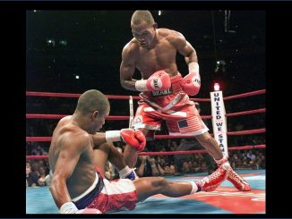 NEW YORK, UNITED STATES: WBC-IBF Middleweight Champion Bernard Hopkins (R) of the US knocks down WBA Champion Felix Trinidad of Puerto Rico in the 11th round during their 12 round unification match at Madison Square Garden in New York 29 September, 2001. Hopkins won by technical knockout in the 12th round to secure the undisputed Middleweight Championship. AFP PHOTO Timothy A. Clary (Photo credit should read TIMOTHY A. CLARY/AFP via Getty Images)