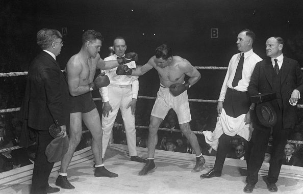 12/14/20- Demsey- Brennan fight (Left to Right)Leo P. Flynn, Brennan Manager; Bill Brennan; Referee Haulamp; Jack Dempsey; Jack Kearns and Joe Humphries, announcer.