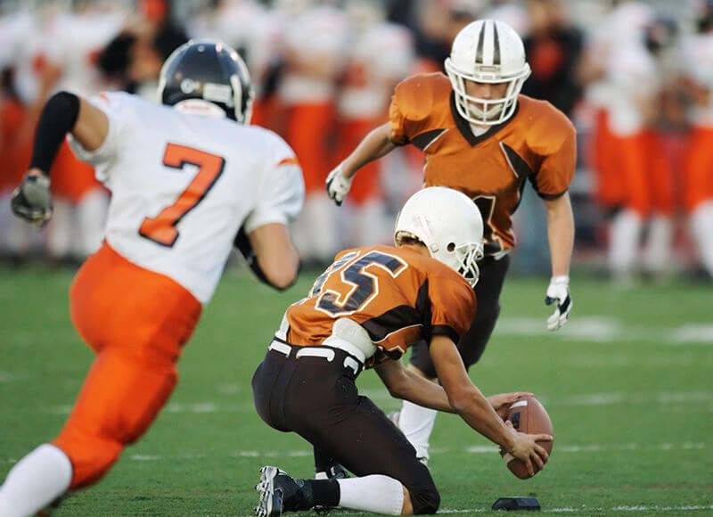 Athletes playing football