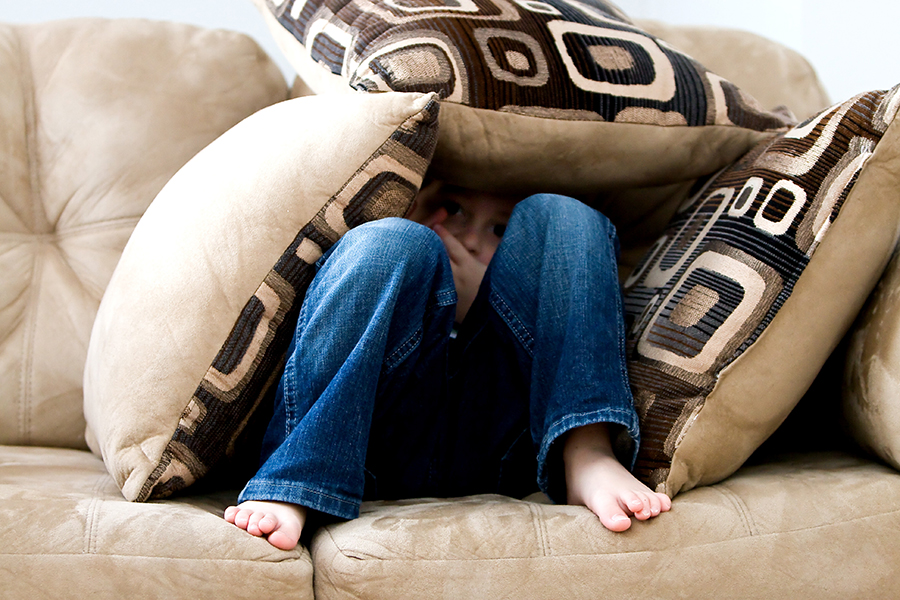 child imagining play in a couch castle